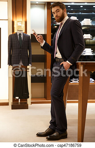 Vertical image of man holding smartphone - csp47186759