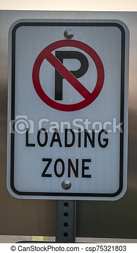 Vertical No Parking road sign on a street - csp75321803