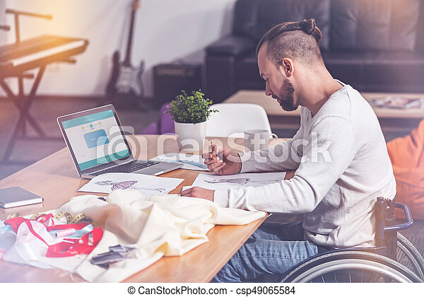 Very attentive designer making sketch - csp49065584