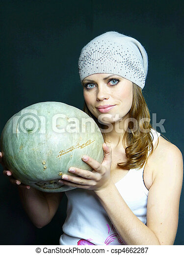very beautiful young blue-eyed girl with a pumpkin in hands - csp4662287
