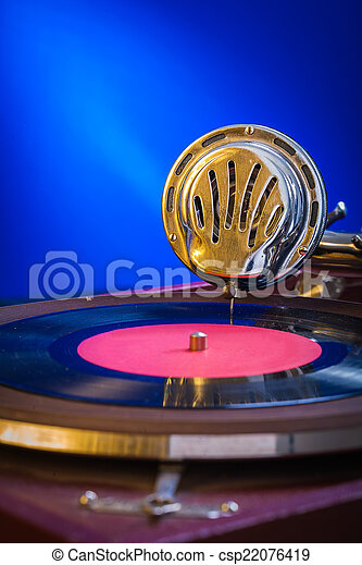 very close up view on gramophone on blue background - csp22076419