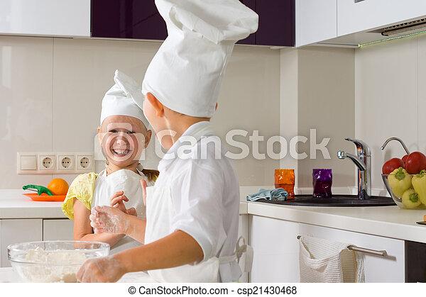 Very Happy Little Chefs Baking in Kitchen - csp21430468