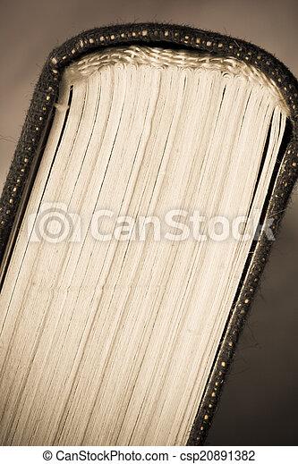 Very Old Book closeup art retro style toned - csp20891382