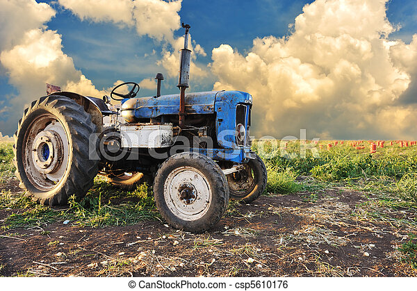 Very old tractor in field, different parts - no trademark at all - csp5610176