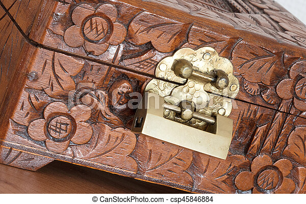 Very old wooden chest with simple lock - csp45846884