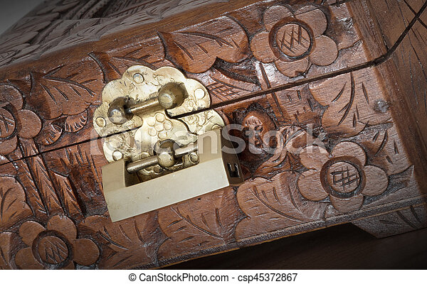Very old wooden chest with simple lock - csp45372867