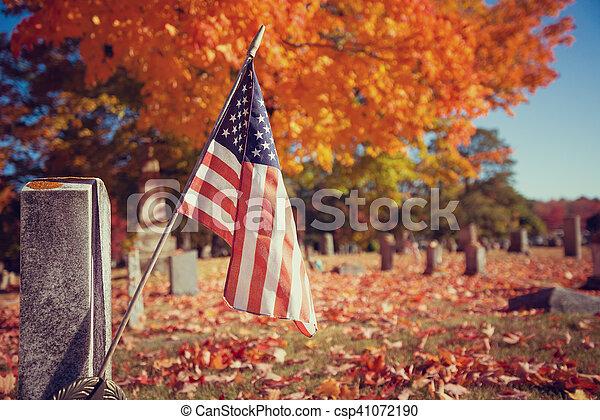 Veteran flag in autumn cemetery - csp41072190