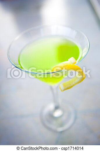 Vibrant green apple martini with garnish - csp1714014