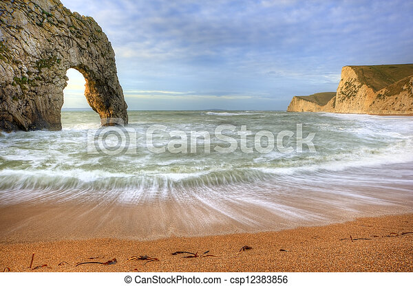 Vibrant sunrise over ocean with rock stack in foreground - csp12383856