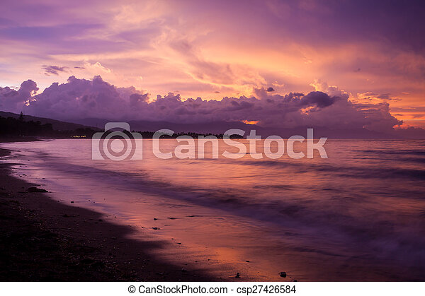 Vibrant tropical sunset at Bali indonesia - csp27426584