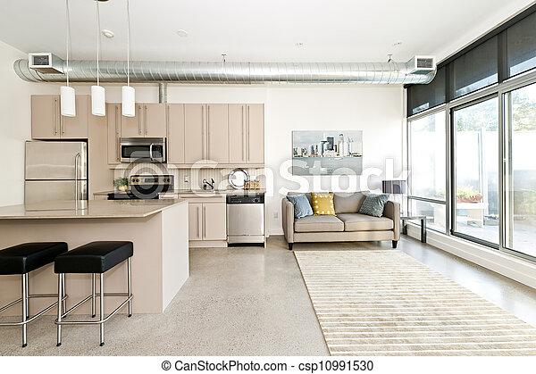 Cocina moderna y sala de estar - csp10991530