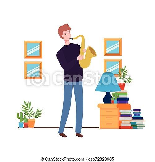 Un joven con saxofón en la sala - csp72823985