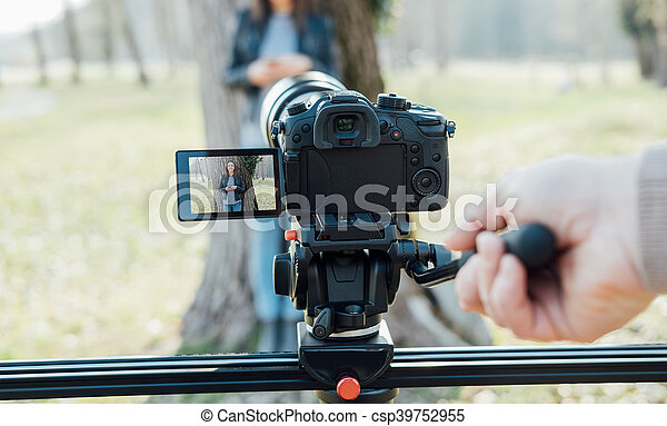 Video shooting at the park - csp39752955
