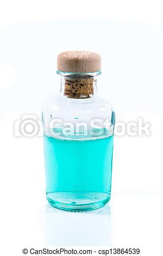 Una botella de vidrio de líquido azul turquesa - csp13864539