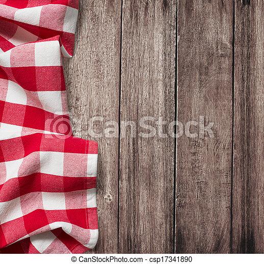 Una vieja mesa de madera con mantel rojo y espacio de copiado - csp17341890