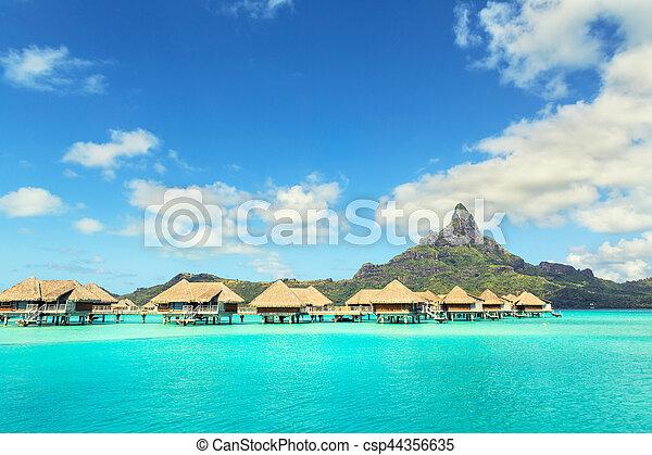 View at Otemanu mountain and luxury bungalow at Bora Bora island, Tahiti, French Polynesia - csp44356635