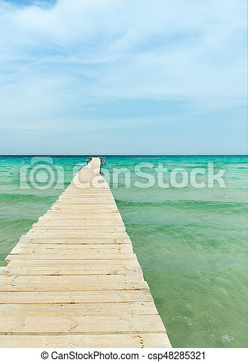 View from a wooden pier over the ocean - csp48285321