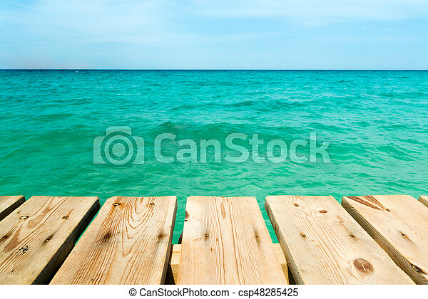 View from a wooden pier over the ocean - csp48285425