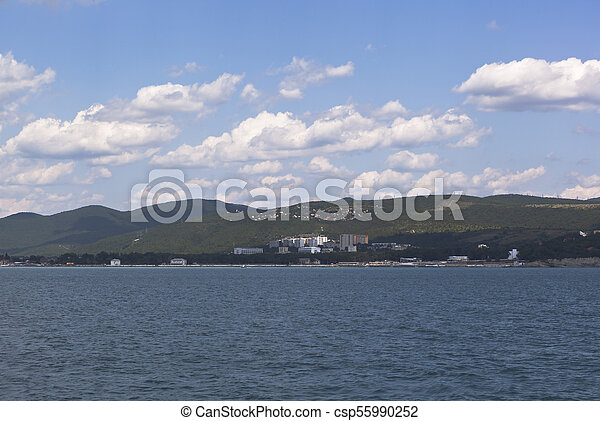 View from of the sea on resort settlement Divnomorskoe in Gelendzhik district of Krasnodar region - csp55990252