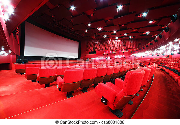 View from stairs on screen and rows of comfortable red chairs in illuminate red room cinema - csp8001886