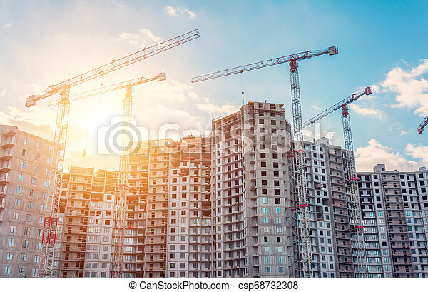 View large-scale construction of a residential complex with a view of construction cranes. - csp68732308