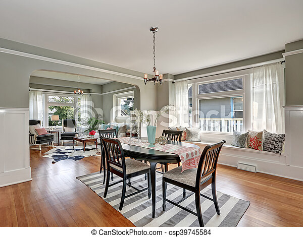 View of a classic dining room with gray walls and hardwood floors
