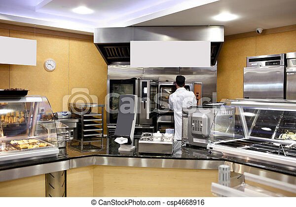 View of a kitchen with baker preparing breads and baguettes in a cafeteria - csp4668916