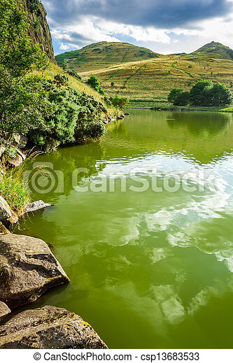 View of a mountain lake at the saint Patrick Day's - csp13683533