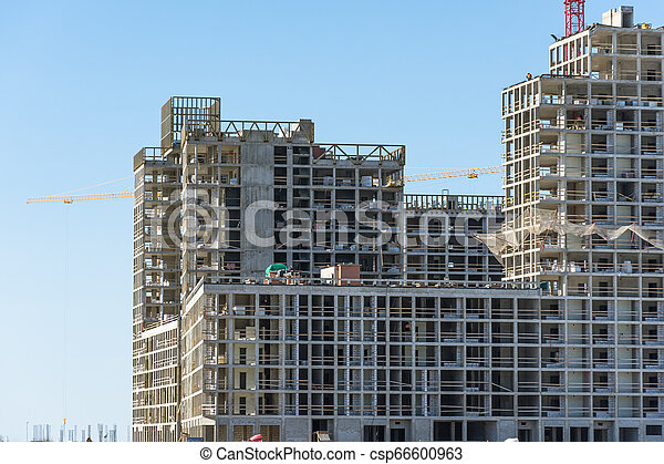 View of a residential complex under constructio. Large-scale building of the city - csp66600963