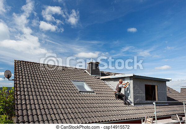 View of a rooftop with a working roofer - csp14915572