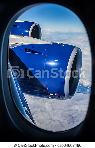 View of an airplane wing out the window - csp84607466