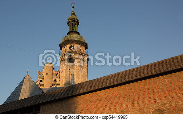 View of an old church with a monastery in Lviv at sunrise - csp54419965