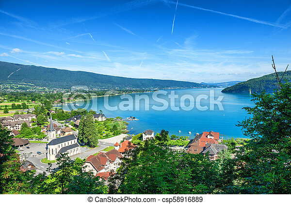 view of Annecy lake in french Alps with Duingt village - csp58916889