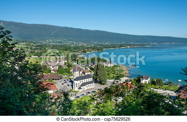 view of Annecy lake in french Alps with Duingt village - csp75629526
