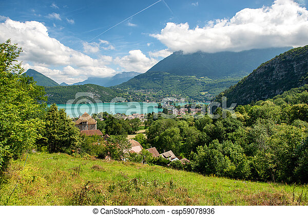 view of Annecy lake in french Alps with Duingt village - csp59078936