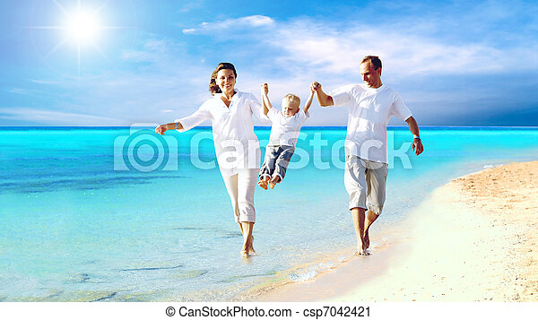 View of happy young family having fun on the beach - csp7042421