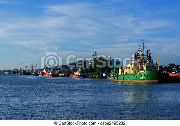 View of industrial ships in the port of Songkhla Lake near by Nang ngam road in the southern sea of Thailand - csp92495232