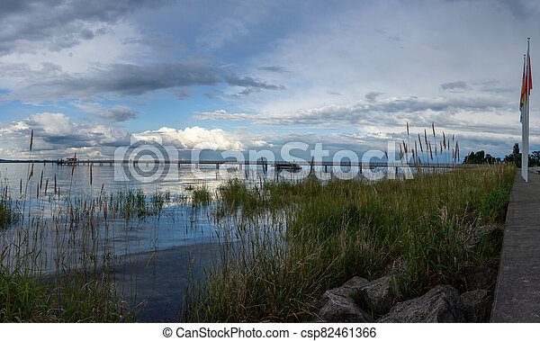 view of Lake Constance with the pier at Altnau in evening light - csp82461366