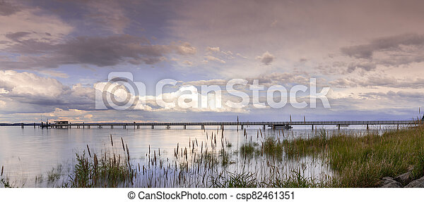 view of Lake Constance with the pier at Altnau in evening light - csp82461351