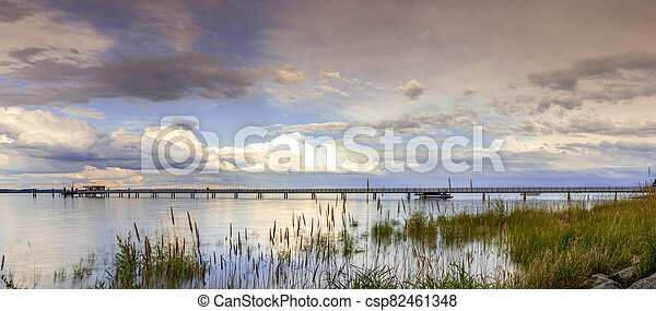 view of Lake Constance with the pier at Altnau in evening light - csp82461348