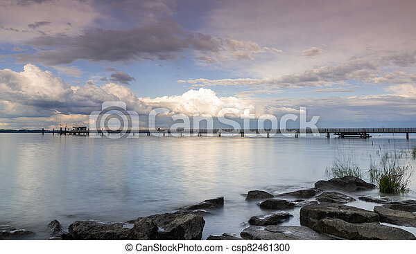 view of Lake Constance with the pier at Altnau in evening light - csp82461300