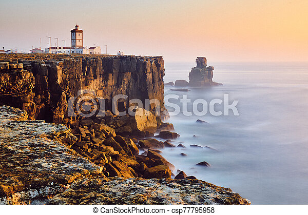 View Of Lighthouse And Sea In Peniche Portugal At Sunset - csp77795958