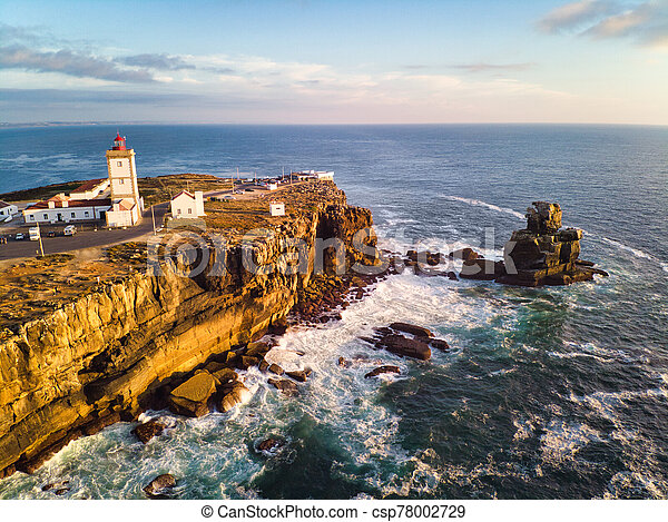 View Of Lighthouse And Sea In Peniche Portugal At Sunset - csp78002729