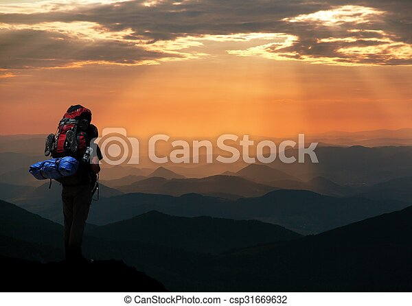 view of man on mountains with big rucksack on back - csp31669632