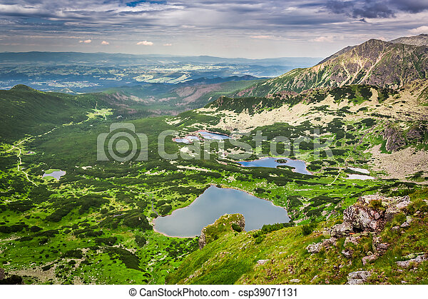 View of mountain lake from the top in summer - csp39071131
