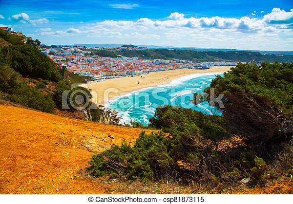 View of Nazare town and the sandy beach seen from high cliff, Portugal - csp81873115