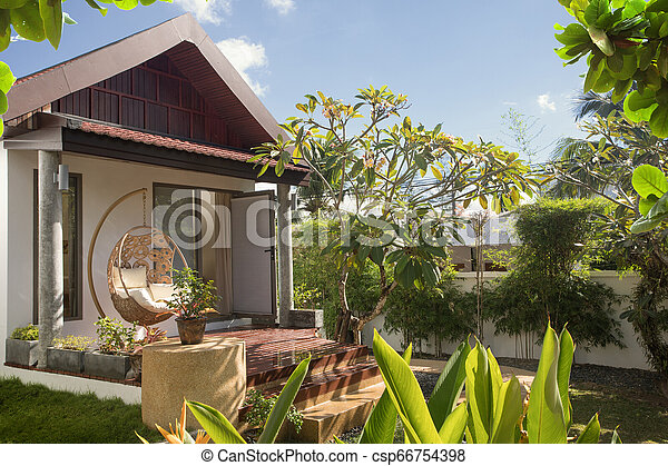 View of nice bamboo hut in summer environment - csp66754398