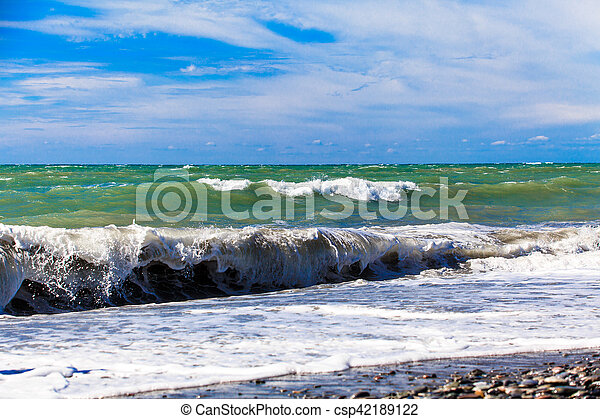 View of storm seascape. Sea background. Waves. waves crashing on shore - csp42189122