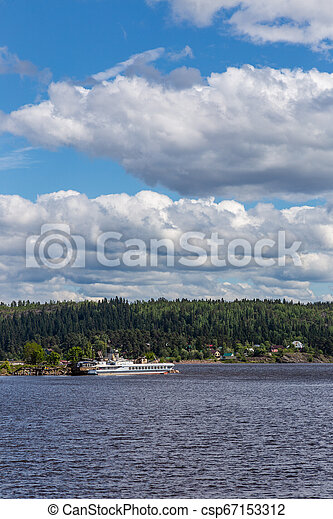 View of the bay shore in Ladoga Lake under a blue sky with clouds near Sortavala, Karelia. Russia - csp67153312
