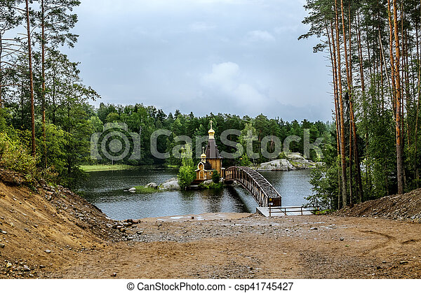 View of the Church of St. Andrew on the island on the lake Vuoksa in Karelia. - csp41745427